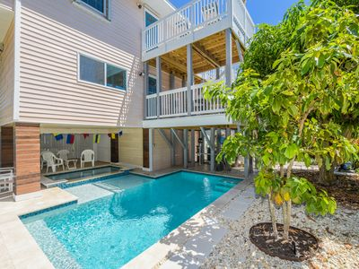 Photo for Beautifully remodeled 3 bedroom luxury home, just steps to BEACH! Brand-new Pool