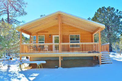 What could be better than a large covered porch to enjoy the smell of the pines, the beautiful views of nature and peace and quite of the forest.