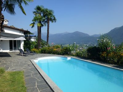 Photo for Fantastic holiday home with private heated pool and lake view
