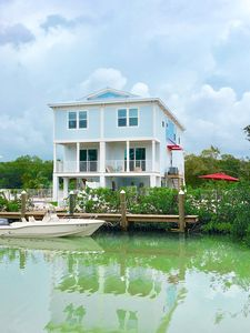 Photo for FlaKeys~beautiful professional decor 4/3~canal front~pool~walk to beach~dock