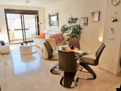 Photo for Luxury, two bed apartment - westerly balcony, mountain & sea views, golf nearby