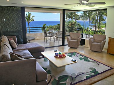 View of the living room, lanai and beach.