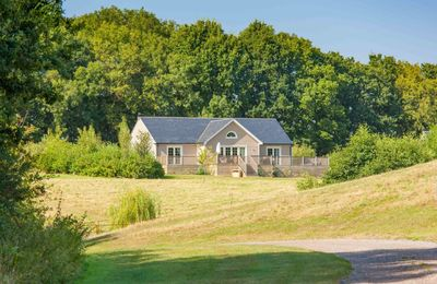 Photo for A delightful lodge with hot tub on Wakes Hall Farm is a haven of peace in 500 acres of private land