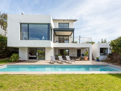 Photo for Beautiful contemporary with ocean and golf views
