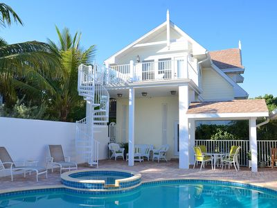 Key West style Carriage House with deck, covered lanai and shared pool