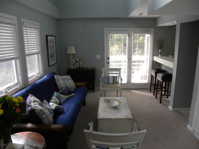 Living room with many windows and vaulted ceiling