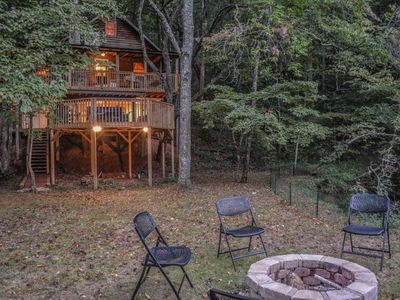 Photo for GAS LOG REMOTE FIREPLACE WIFI NETFLIX HOT TUB ON LARGE COVERED DECK OUTDOOR FIRE PIT ON CREEK WITH S
