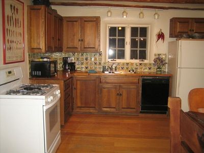 Kitchen. Separate pantry with washer, dryer is off to right.
