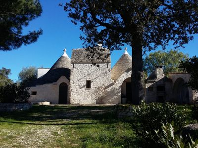 Photo for Trulli villa with private pool surrounded by a thick pine forest and typical olive trees