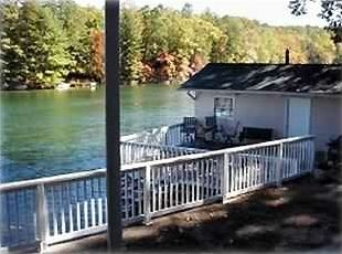 View from lower porch to cove, Sundeck and boat house shown.