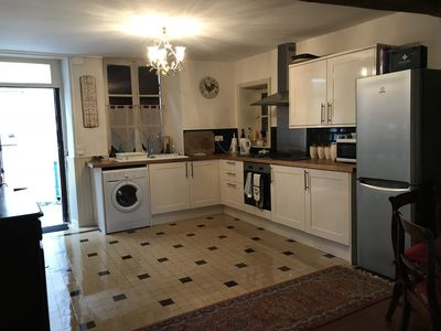 Kitchen with gas hob oven microwave and washing machine