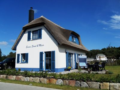 Photo for Close to the beach, loving u. romant. Thatched Cottage on the Breeger Bodden, fireplace, Wi-Fi incl