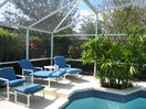 Our pool deck has 4 sunloungers, 2 recliners, 2 footstalls, a table & 4 chairs