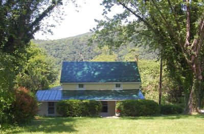 Front of cottage with Maryland Heights in the background