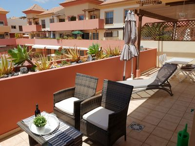 Large terrace with sitting area, sun loungers, dining area