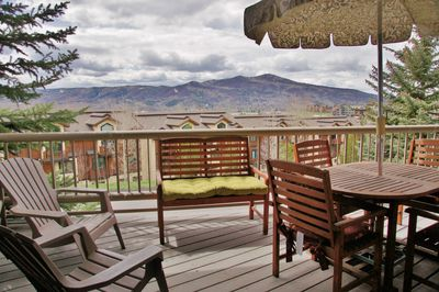 Large covered deck with Emerald Mountain views to the west