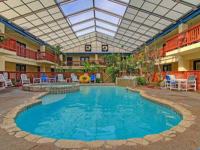 Photo for Charming condo w/ a shared indoor pool & hot tub - walking distance to the beach