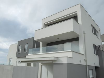 Photo for Deluxe Two-Bedroom Apartment with Terrace and Sea View