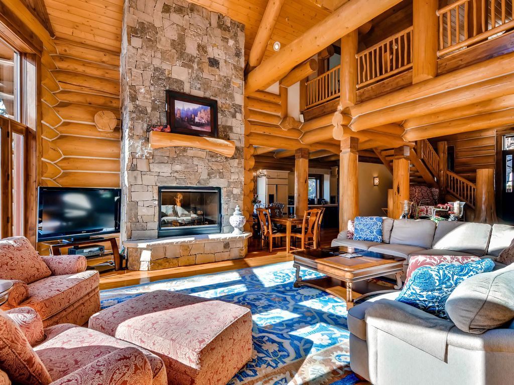 custom log home with large deck outdoor fireplace tub