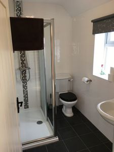 Photo for 6 bed luxury cottage 100 metres from Port Eynon Beach