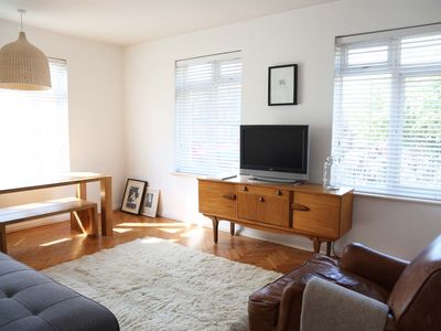 Photo for Chic, spacious, bright 2-bed flat near Brixton Tube