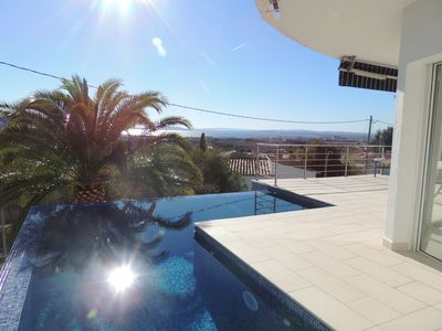 Photo for 3 Reyes -Fantastic, modern Villa with stunning views over the Bay of Roses, Infinity Pool