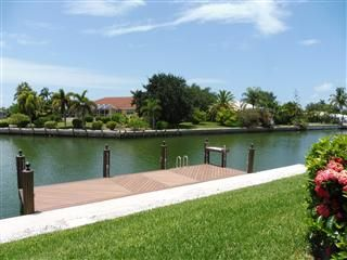 Photo for Bring your boat and your fishing rod!  Waterfront pool home, walk to Tigertail Beach!