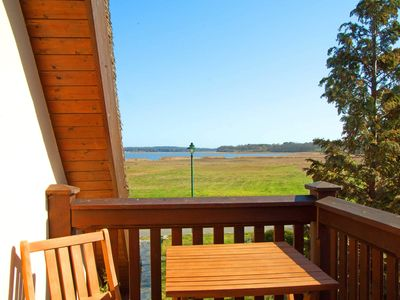 Photo for The Thatched Cottage Am See App. Amber with lake view - The Reethaus Am See - fantastic location - lake view