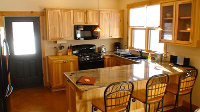 The kitchen with new appliances, granite countertop and everything you need.
