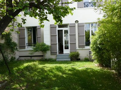 Photo for CHARMING APARTMENT WITH GARDEN NEAR PARIS