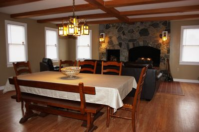 Great room with massive stone fireplace and gas fire logs