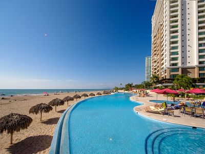 Photo for Beachfront Condo with Ocean Views, Sparkling Pools and Fitness Center