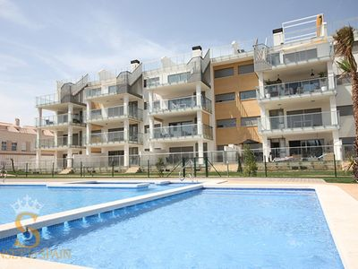 Photo for Lovely furnished apartment with terrace looking over the different pools