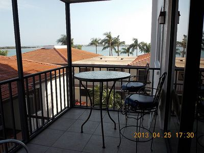 Photo for Incredible 3rd floor condo with southern water views towards Tierra Verde!