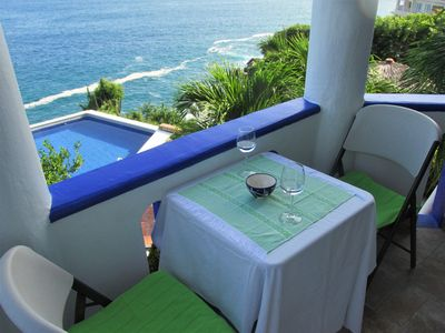 balcony and view of front pool overhanging the sea