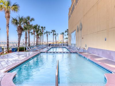 Photo for Luxurious waterfront condo w/gulf views, shared pools, gym &  arcade!