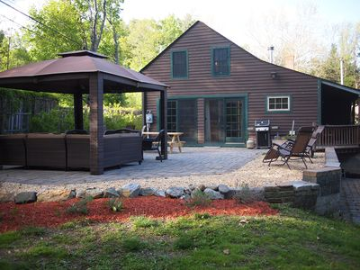 Large patio with plenty of seating and a gas bbq grill