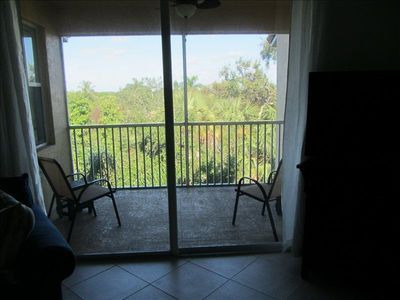 Enjoy the view of the preserve while having a refreshment on the lanai
