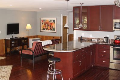 Granite counter and TV area in background.