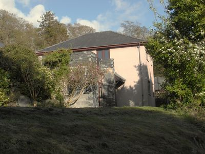 Photo for Large warm modern Harlech house With Sun Terrace above Harlech Castle itself.