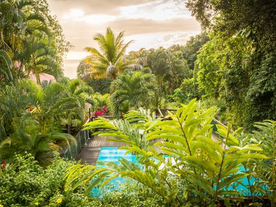 Photo for Holiday house with pool in a tropical garden, close to the beach