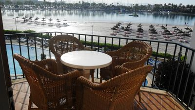 Photo for Carabella 93. Beach front apartment sea views, swimming pool, A/C, 4/6