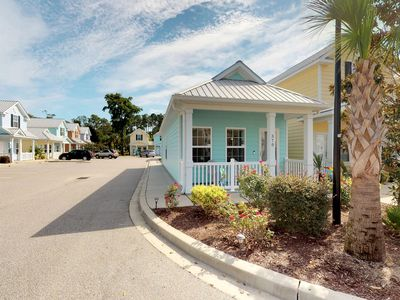 Photo for Beautiful beach cottage w/shared pool, just steps from the ocean!