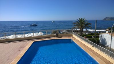 Photo for Apartment Vista al Mar with pool and direct sea view on the waterfront