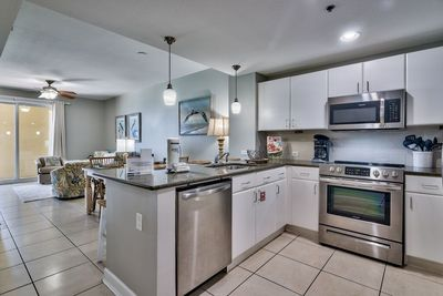 Gorgeous updated kitchen with white cabinets, stainless steel appliances and all the small appliances you will need!