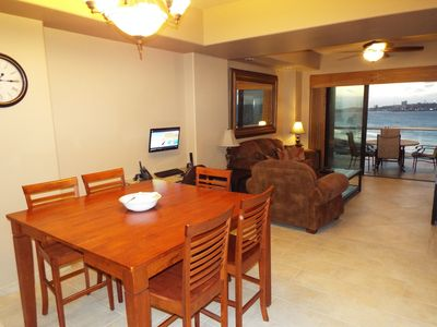Dining area with computer desk and living room behind