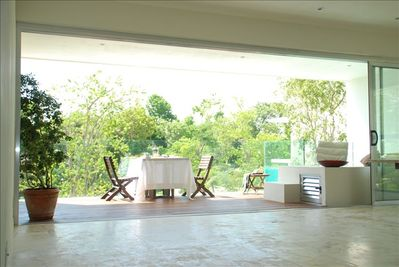 View of deck & pool from living space