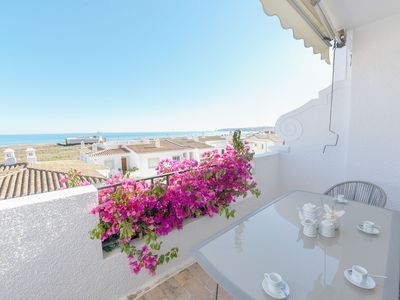 Photo for Casa Lowen, Stunning views over the beach & only 2 m walk to Meia Praia beach