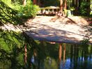 Waterfront tranquility, private & easily accessible.  Creek and redwoods setting