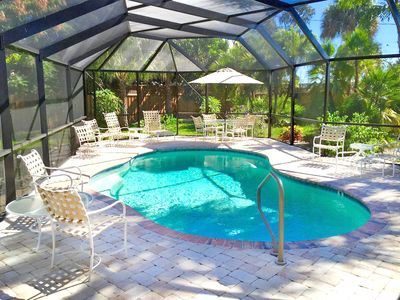 Photo for Tropical Oasis - 3 Mins. to Beach, Heated Pool, 4 Season Living at its Best!